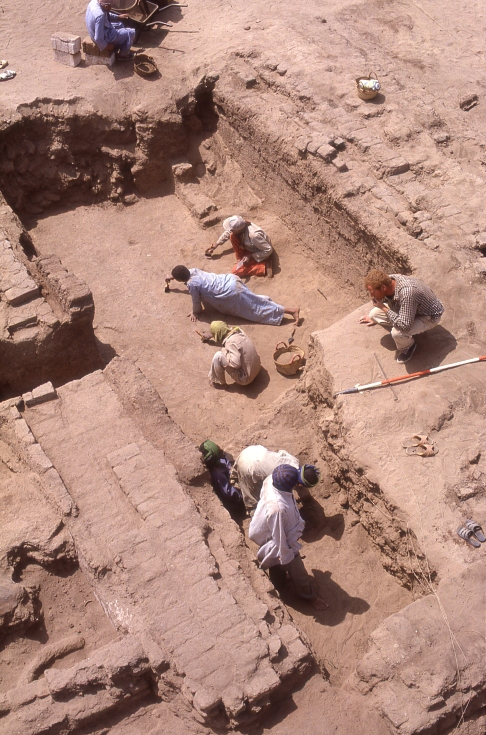 Part of the monastic complex: The monks cleared out some of the Amarna-period rooms and rebuilt them to provide the various elements of a monastery, here perhaps a refectory, its floor at a lower level than that of the surrounding ground. Archaeologist Duncan Schlee supervises a stage in the excavation.
