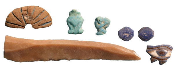 Everyday objects: Many objects recovered during fieldwork at Amarna are small personal items, or manufacturing pieces; here, a group of pendants, beads, wedjat-eye ring, flint knife and possible piece of a spindle whorl.